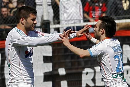 Olympique Marseille's Gignac celebrates with teammate Valbuena after scoring against OGC Nice during Ligue 1 match in Nice