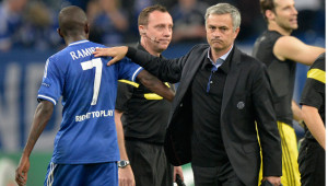 Chelsea's manager Jose Mourinho, right, pats Chelsea's Ramires on the back after winning the Champio