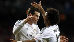 Real Madrid's Bale celebrates his goal against Real Valladolid with teammate Marcelo during their Spanish First Division soccer match in Madrid